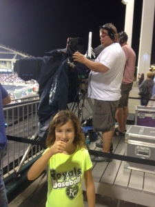 """Hey Emma, take a picture next to the camera guy and tell Nana that you're helping film the Royals!"""